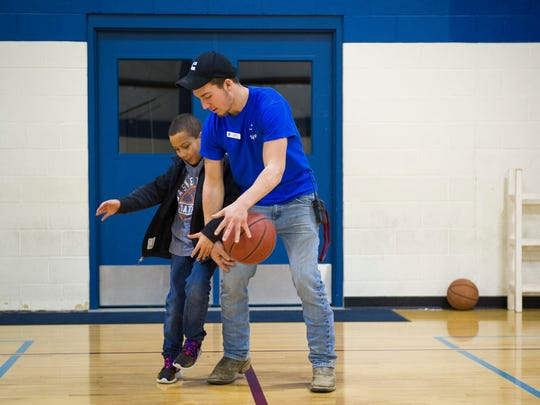 Kaynin Neblett, 9, left, plays basketball with YMCA staff member Lucas Adkins, 16, both of Henderson, at the Henderson County Family YMCA, Tuesday, Jan. 24. 2017. In 2016, the Henderson County Family YMCA offered financial assistance services to 3,874 people for a value of $421,758.