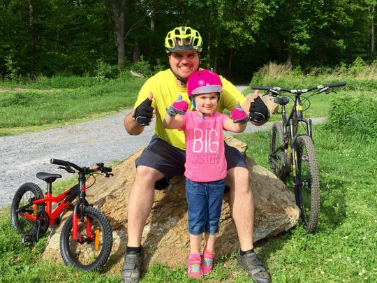 Matt Mowry and his daughter Madilyn, 5, during a ride