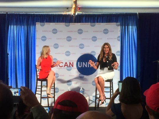Jenner, right, speaks at an American Unity Fund brunch
