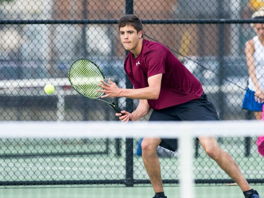 Henderson County junior Jon Nunez rallies with Caldwell County's Ben Knight in the Second Region boys singles final at the Doc Hosbach Tennis Complex in Henderson, Ky., Wednesday, May 9, 2018. Nunez lost to Knight 6-2, 7-5.