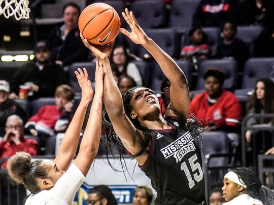 Mississippi State's Teaira McCowan (15) shoots against Mississippi's Cecilia Muhate (10) during an NCAA college basketball game in Oxford, Miss., Thursday, Feb. 21, 2019. (Bruce Newman/The Oxford Eagle via AP)