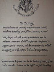 Xavier Kennedy, 9, presented Destiny Carroll, 8, a