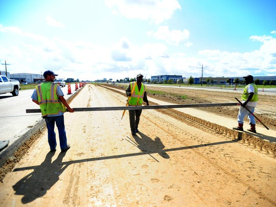 Highway workers continue road construction on U.S. Highway 90 in Broussard, LA, along the planned Interstate 49 corridor, Monday, Oct. 28, 2013. Paul Kieu, The Daily Advertiser