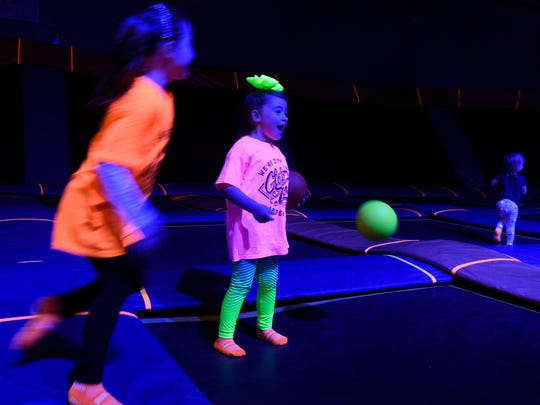 Five-year-old friends Mila Thompson (left) and Isabella Lane play together during the GLOW Jump at Sky Zone in Evansville, Ind., Sunday, Dec. 31, 2017. Sky Zone holds Toddler Time, for children old enough to walk through 5 years of age, every Sunday from 10 a.m to noon.