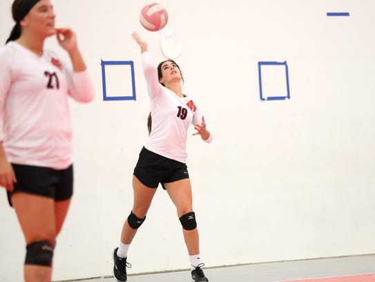 NFC's Chloe Culp serves the ball during their match