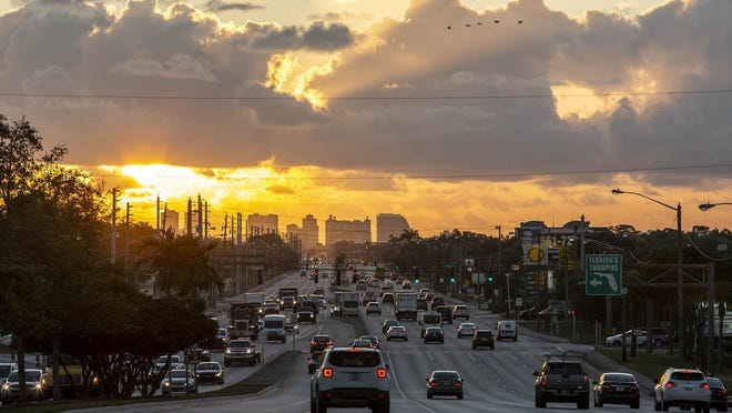 Traffic was lighter than usual on the Monday morning commute on Okeechobee Boulevard into West Palm Beach as people stayed home to avoid unnecessary contact during the coronavirus pandemic.
