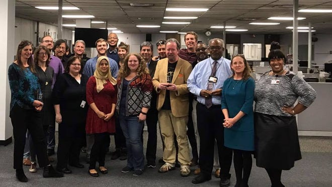 Some of the Tallahassee Democrat newsroom staff during a Thanksgiving luncheon on Nov. 16, 2017.
