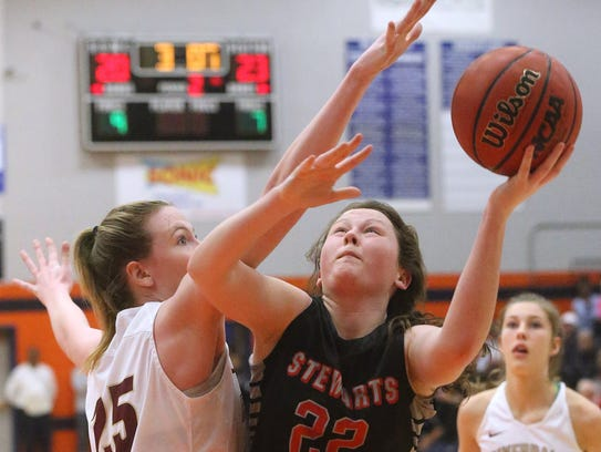 Stewarts Creek's Morgan McCrary (22) goes up for a