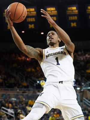 Michigan guard Charles Matthews (1) goes to the basket in the first half on Sunday, Nov. 26, 2017, at Crisler Center.