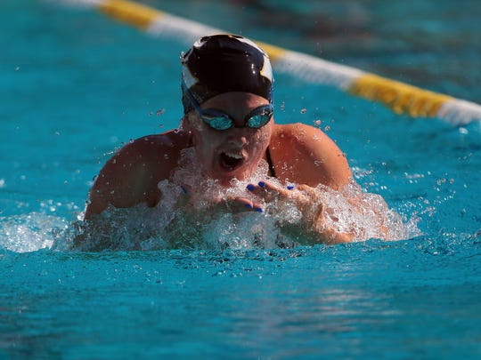 Xavier's Erin Fleet competes in the 200 individual medley on her way to an event win as Palm Springs hosts Xavier in a high school swim meet on Monday, April 25, 2016, at the Palm Springs Swim Center.
