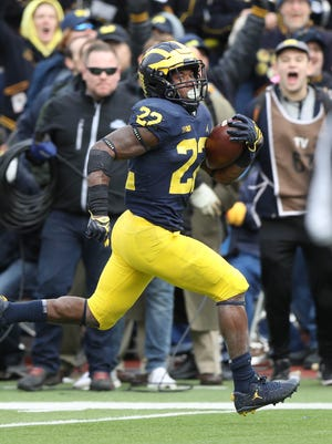 Michigan running back Karan Higdon runs for a 49-yard touchdown during the fourth quarter of the 35-14 win over Rutgers on Saturday at Michigan Stadium.