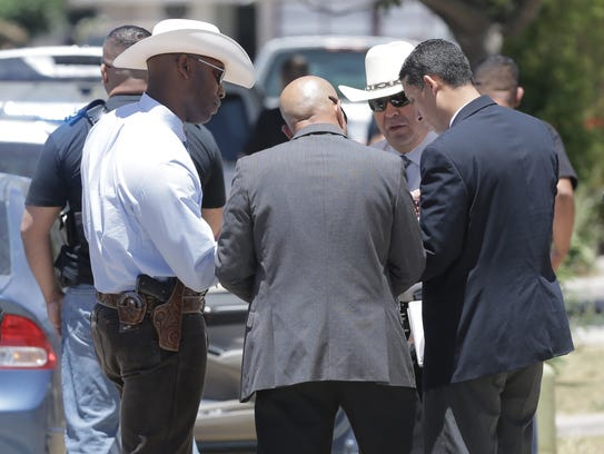 Texas Rangers arrive on the scene of an officer involved