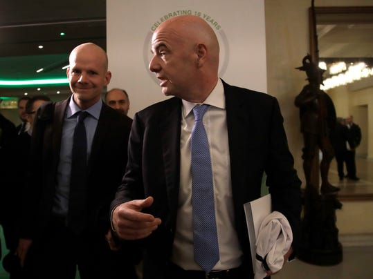 FIFA president Giani Infantino leaves at the end of European Club Association's (ECA) 20th General Assembly, in the organization's 10-year anniversary in Rome, Tuesday, March 27, 2018. (AP Photo/Alessandra Tarantino)