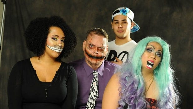 Makeup artist Iowani Unpingco, back, transformed Assistant Digital Editor Michelle Conerly, left, Community Editor Duane M. George, center, and Special Sections Editor Amanda Blas for Halloween
