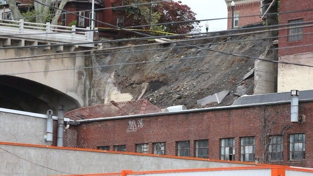 A parking lot on Mulberry Street in Harrisburg collapsed onto a building on Cameron Street taking a vehicle along with it. (Sean Simmers   ssimmers@pennlive.com)