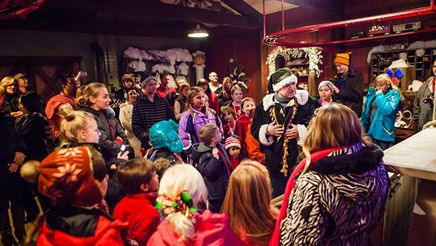 Children learn how Santa keeps his overnight delivery service humming during a tour at the North Pole Experience.