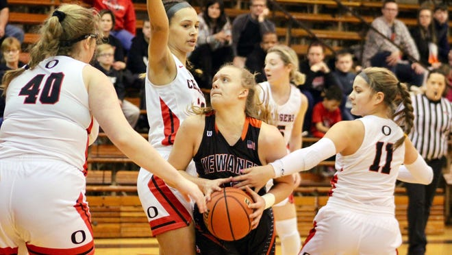 Kewanee guard Gracey Damron is surrounded by Orion defenders as she cuts through the lane for a shot from the low point.