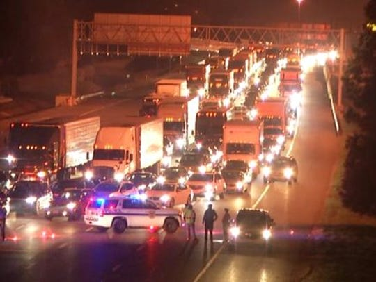 Traffic backed up after gas leak closed Delaware Memorial Bridge.