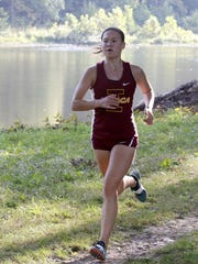 Ithaca's Lizzy Rayle runs to first place in the girls varsity race Tuesday at the STAC West championship meet at Pirozzolo Park in West Elmira.