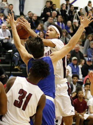 Elmira's Nahjor Mack goes up for a shot as Mike Limoncelli of Horseheads defends during a game Dec. 18 at Elmira High School. Those teams are among the eight boys teams in the National Division at the Josh Palmer Fund Elmira Holiday Inn Classic.