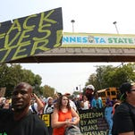 People march during a Black Lives Matter protest near the front gate of the Minnesota State Fair on Aug. 29.