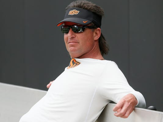 FILE - In this Saturday, April 15, 2017 file photo, Oklahoma State head coach Mike Gundy is pictured before an intra squad spring NCAA college football game in Stillwater, Okla. Gundy said the Cowboys are aware that outside expectations are higher than usual. (AP Photo/Sue Ogrocki, File)