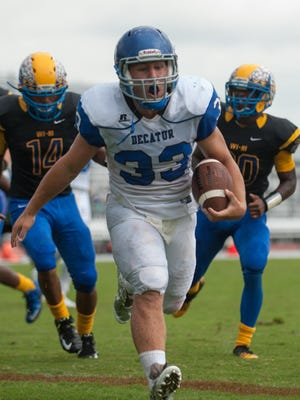 Stephen Decatur running back Dryden Brous (33) rushes for a three-yard touchdown against Wicomico High on Saturday afternoon at Wicomico County Stadium.