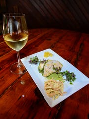 The Back Porch CafeŽ located in Rehoboth, features a Torchon of savoy cabbage, jumbo lump crab and shrimp, avocado, celery root, preserved lemon, burrito cheese, peach, prosciutto and arugula on their dinner menu.