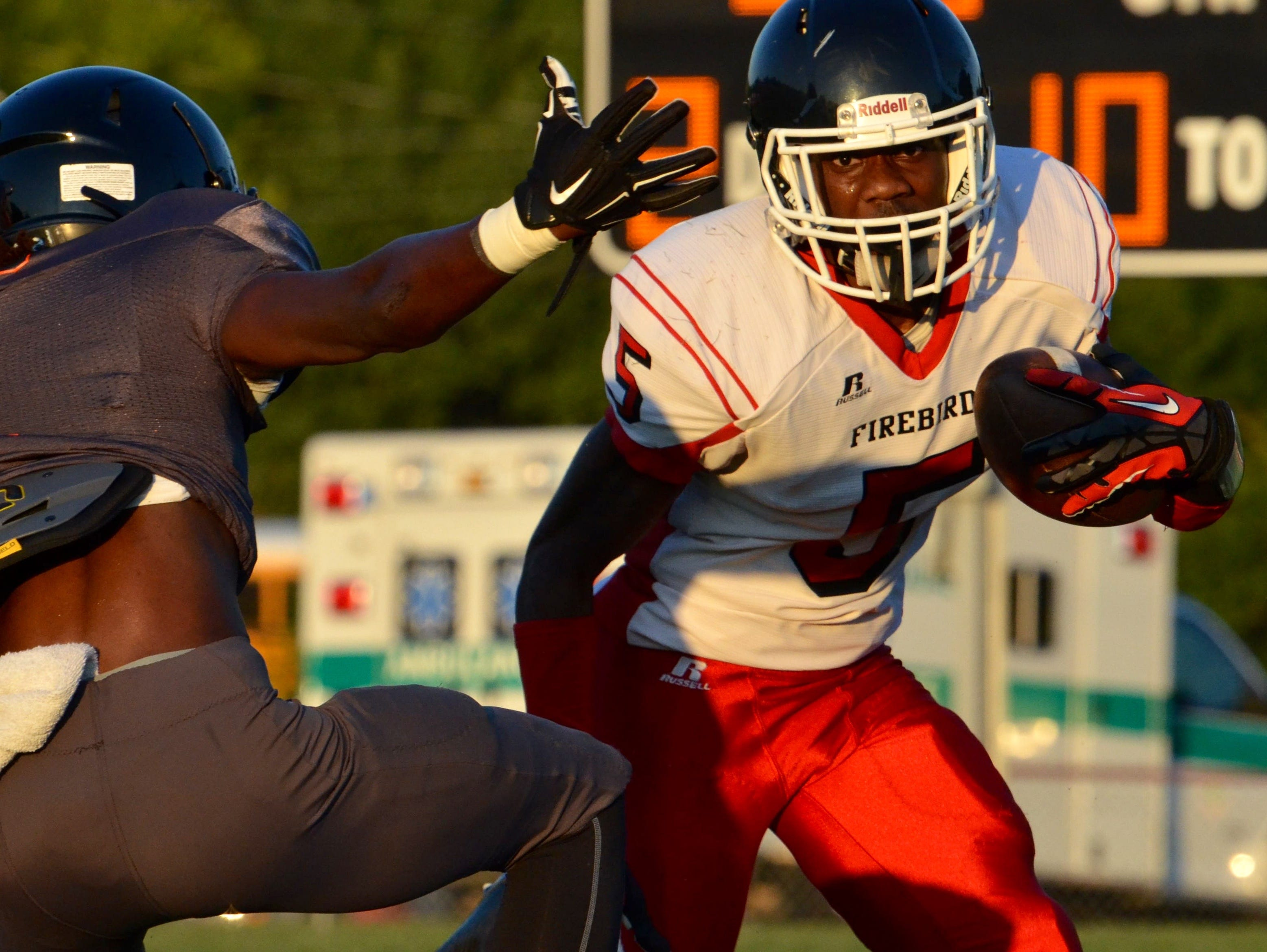 Pearl-Cohn senior Rontavius Groves picks up yards after a catch during Thursday's Metro Football Jamboree