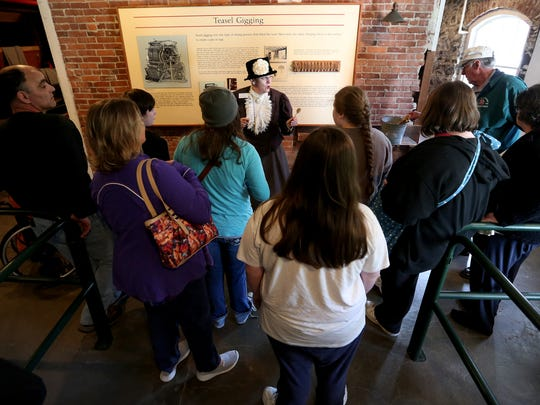 Holly Miles leads a tour as Fanny Kay Bishop, the daughter of Thomas Kay, the founder of the Mission Mill, for students and parents with the Oregon Connections Academy at the Willamette Heritage Center in Salem on Thursday, March 31, 2016.
