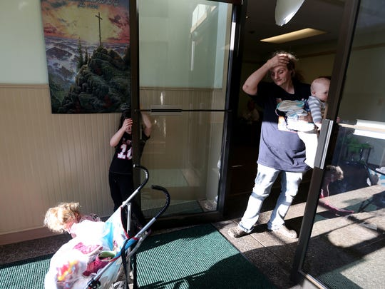 Melody Reitzer, 6, holds the door for her mom, Carolyn Reitzer, and two of her sibling at the Simonka Place women's and children's shelter in Keizer on Wednesday, April 20, 2016. Melody takes the bus to a school ten miles from the homeless shelter.