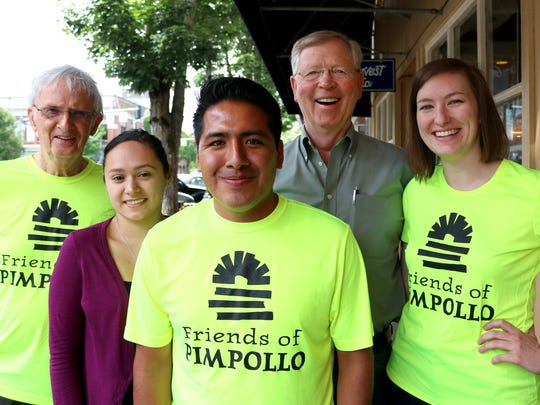 Recent college graduate Flaviano Gopar Martinez, center, will be honored at noon Thursday at the annual Cinco de Mayo Celebration, sponsored by Friends of Pimpollo, an organization that provides educational support to states in southern Mexico. Joining Flaviano were John Kerr, from left, Carina Garibay, Jim Moran and Laura Ruggles.