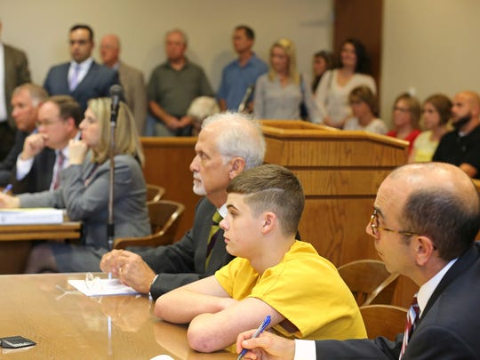 James 'Austin' Hancock sits between his two lawyers, Charles Rittgers (left) and Ed Perry, during his sentencing.