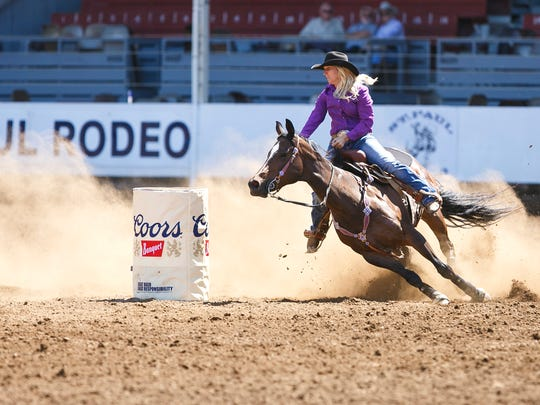 Amber Leigh Moore of Salem competes in barrel racing