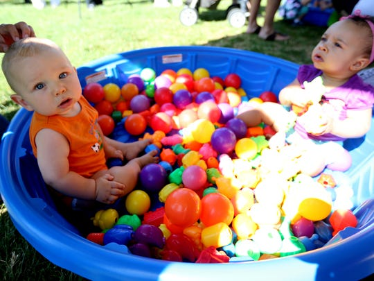 Duncan Hofman, 8 months, and Auriella Fields, 9 months, play in a ball pit during the Family Building Blocks Family Fest at Riverfront Park in Salem on Saturday, Aug. 6, 2016.