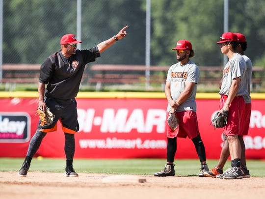Volcanoes manager Jolbert Cabrera coaches players on Thursday, July 13, 2017, at Volcanoes Stadium in Keizer. Cabrera is in his first season as manager of the team.