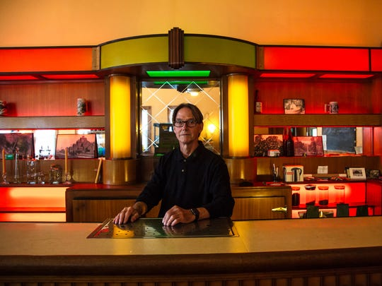 Mike Mallow, 69, stands inside the Art Deco bar he purchased 15 years ago in Toivola in Michigan's Upper Peninsula on Aug. 22, 2017. The century-old bar, which was known as Fanny's Tavern, had been vacant for three decades when he found it.