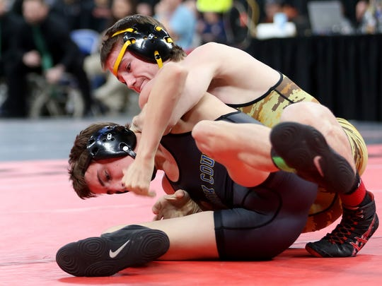 Cascade's Kane Nixon, top, and Crook County's Zachary Mauras compete in the OSAA Wrestling State Championships Class 4A final for weight 126 at Veterans Memorial Coliseum in Portland on Saturday, Feb. 17, 2018. Nixon was the champion.