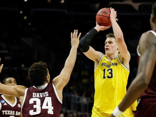 Michigan forward Moritz Wagner (13) shoots against Texas A&M center Tyler Davis (34) during the first half of Sweet 16 of the NCAA tournament in Los Angeles on Thursday, March 22, 2018.