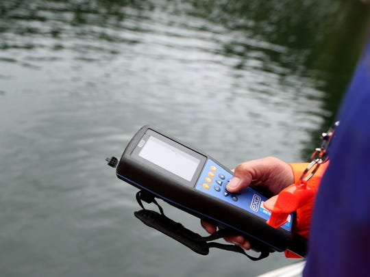 Beth Tanner, a field technician with the City of Salem, uses a sonde to measure water chemistry on Blowout Creek at Detroit Lake on Thursday, June 7, 2018. Water samples are being taken and tested everyday as a toxic algae bloom is being detected.