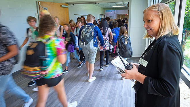 Switzerland Point Middle School principal Sandra Brunet stands in a hallway during a class change at the school  on the first day of school for St. Johns County public school students last year.
