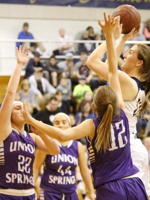 Elmira Notre Dame's Mary Foster puts up a shot as Taylre Perkins (22), Shelby Koch (44) and Baylee Wiler (12) defend for Union Springs on Tuesday during a Section 4 Class C first-round game at Notre Dame.