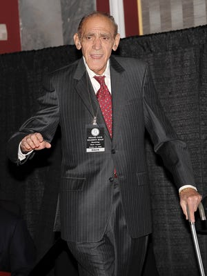 """FILE - In an Oct. 24, 2008 file photo, actor Abe Vigoda attends the Friars Club Roast of """"Today Show"""" host Matt Lauer in New York. Vigoda, whose leathery, sunken-eyed face made him ideal for playing the over-the-hill detective Phil Fish in the 1970s TV series `Barney Miller' and the doomed Mafia soldier in `The Godfather,' died in his sleep Tuesday, Jan. 26, 2016, at his daughter's home in Woodland Park, N.J. He was 94. (AP Photo/Evan Agostini, File)"""