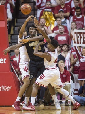 Purdue Boilermakers forward Caleb Swanigan (50) tries to pass off the ball as he's double-teamed by Indiana Hoosiers guard Robert Johnson (4), right, and forward Juwan Morgan (13) during the second half of an NCAA men's college basketball game at Indiana University's Assembly Hall in Bloomington, Ind., Saturday, Feb. 20, 2016. IU won, 77-73.