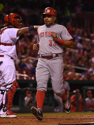 Cincinnati Reds center fielder Hernan Iribarren (33) scores a run against the St. Louis Cardinals at Busch Stadium.