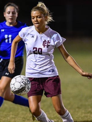 Henderson's Maddie Bell takes a pass in front of Crittenden County's Cassandra Newcome as the 11th-ranked Henderson County Lady Colonels play Crittenden County in the first round of the Second Region Girls Soccer Tournament Monday at Colonel Field, October 17, 2016.