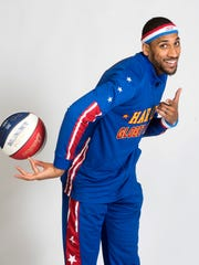 Harlem Globetrotter Zeus McClurkin gives a preview of his basketball skills. The Globetrotters forward and the rest of the gang are scheduled to play at the Pensacola Bay Center on Monday.