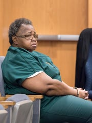 Veronica Posey, one of three defendants charged in the death of Dericka Lindsay, waits in court in March 2018.