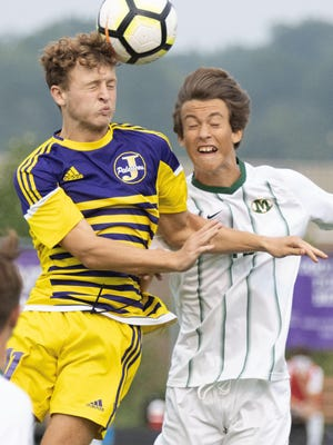 Jackson's Evan Wilson heads the ball in a game against Medina on Thursday, Sept. 10, 2020.