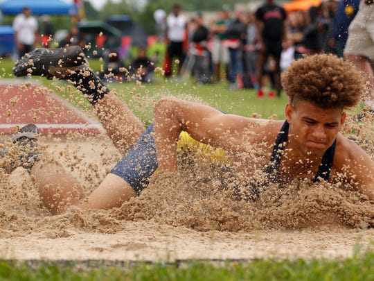 Grand Ledge's Kavion Autrey lands in long jump in the MHSAA Division 1 track and field finals, Saturday, June 2, 2018, at East Kentwood High School. Autrey placed second.